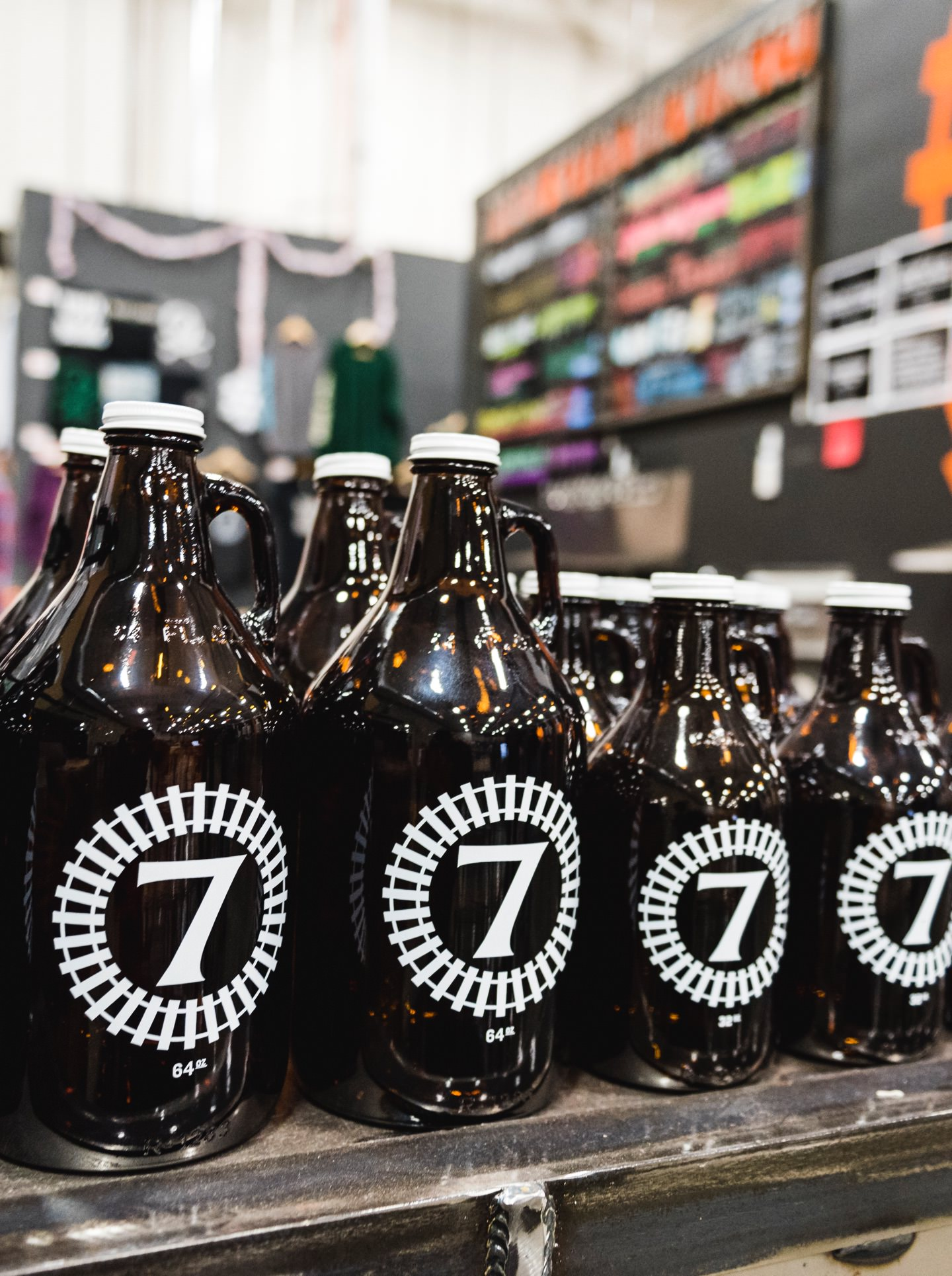 Beer Growler bottles with Track 7 logo